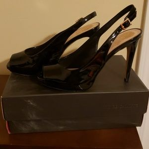 Sling back patent leather pumps